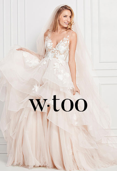 model wearing wtoo wedding dress